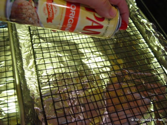 baking sheet with aluminum foil a rack and spray with PAM.