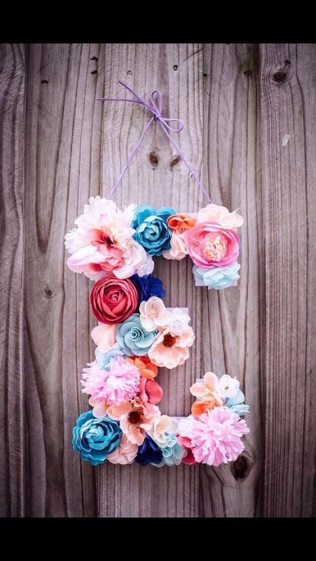 Buy wood letter, hot glue fake flowers