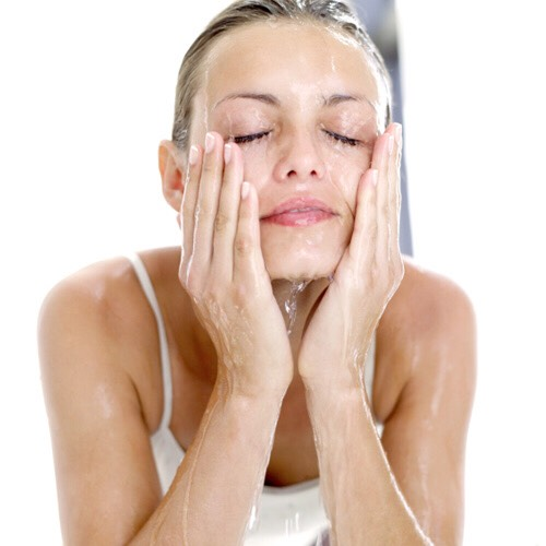 Wash your face, this will get rid of oil from shampoo and conditioner that was left on the face; use your own face wash routine.  .