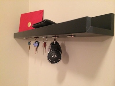 9. Magnetic Storage  You can easily turn an IKEA shelf into a keyholder by attaching a set of magnets to the bottom of it! via IKEA Hackers