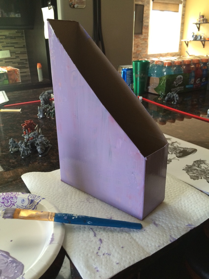 Simply cut a cereal box into this shape and paint it any color you would like. This color took 2 coats. It depends on the color of the paint and the color of the box to determine how many coats you will need to use.