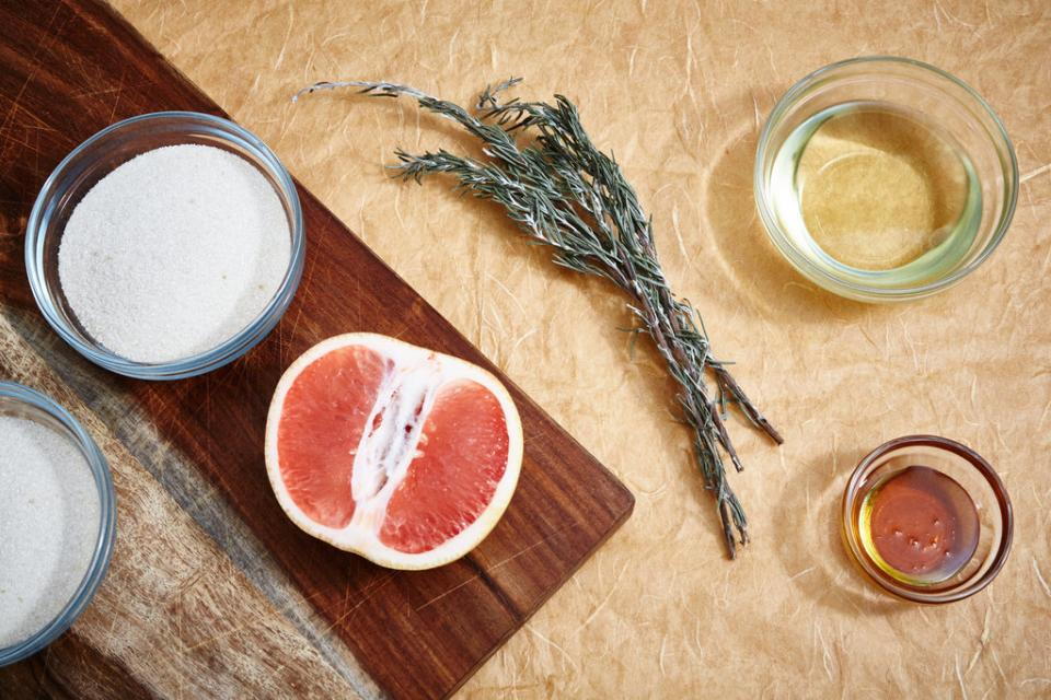 The Ingredients 2 cup coarse brown sugar 1 cup almond oil 2 Tablespoons honey 8 drops grapefruit essential oil 4 drops rosemary essential oil 2 sprigs fresh rosemary (to garnish)