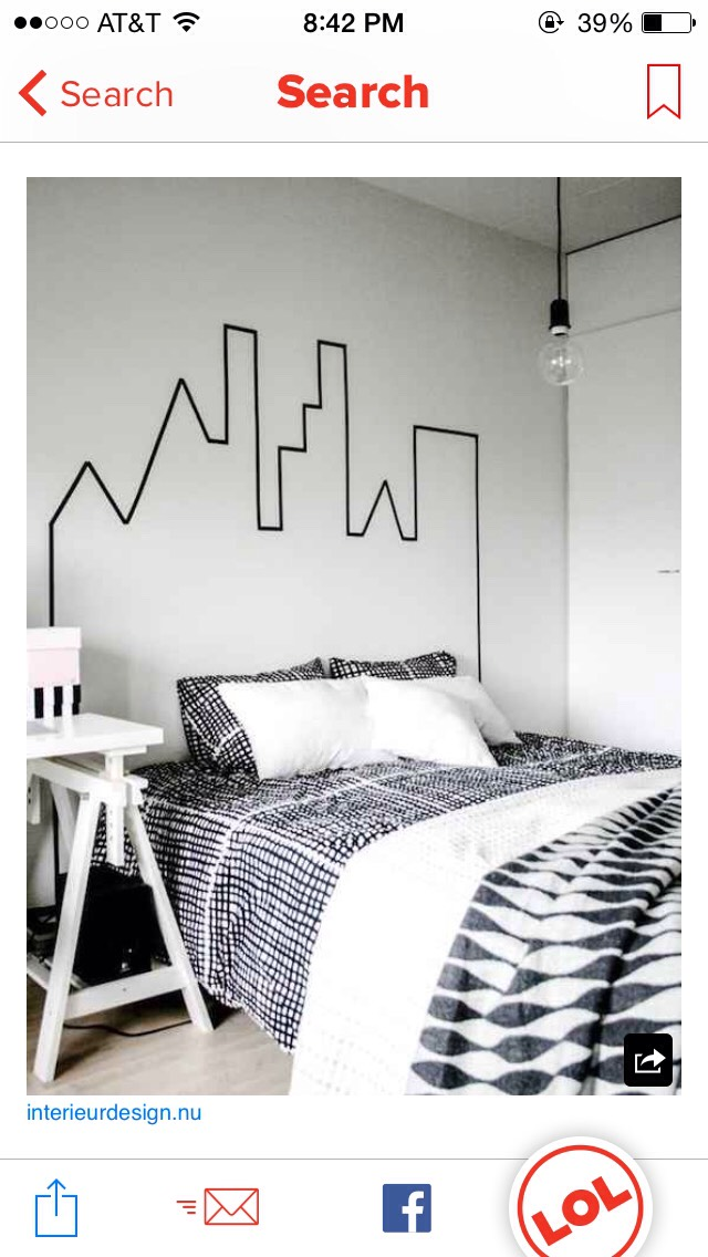 Use some tape to create cool wall designs like this skyline one here!