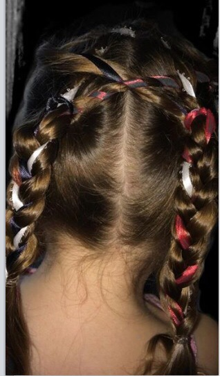 Another view of my three year old daughter styling this braid.  (Sorry the red ribbon had issues when capturing the image.)