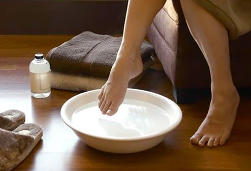 Foot soaks In warm water, add Epsom salt and baking soda, if you want to make it extra effective add one lemon as it helps to fair skin and shines to your nails. Soak your foot in this mixture for 15 to 20 minutes. use a loofah and scrub your foot to get rid of dead cells. Pat dry & use moisturizer.
