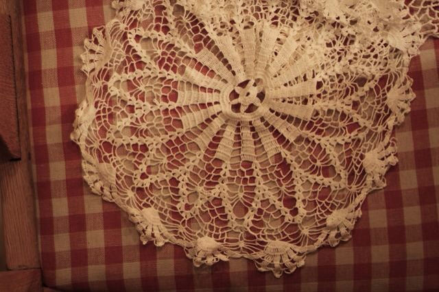 Collect  all the old doily  crochet or lace small tablecloths. Thrift stores always have them.