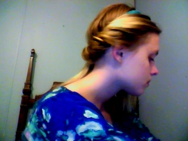 I then go back on this side and bobby pin to keep in place. Once you have half of your head done like this turn and start on the other side.