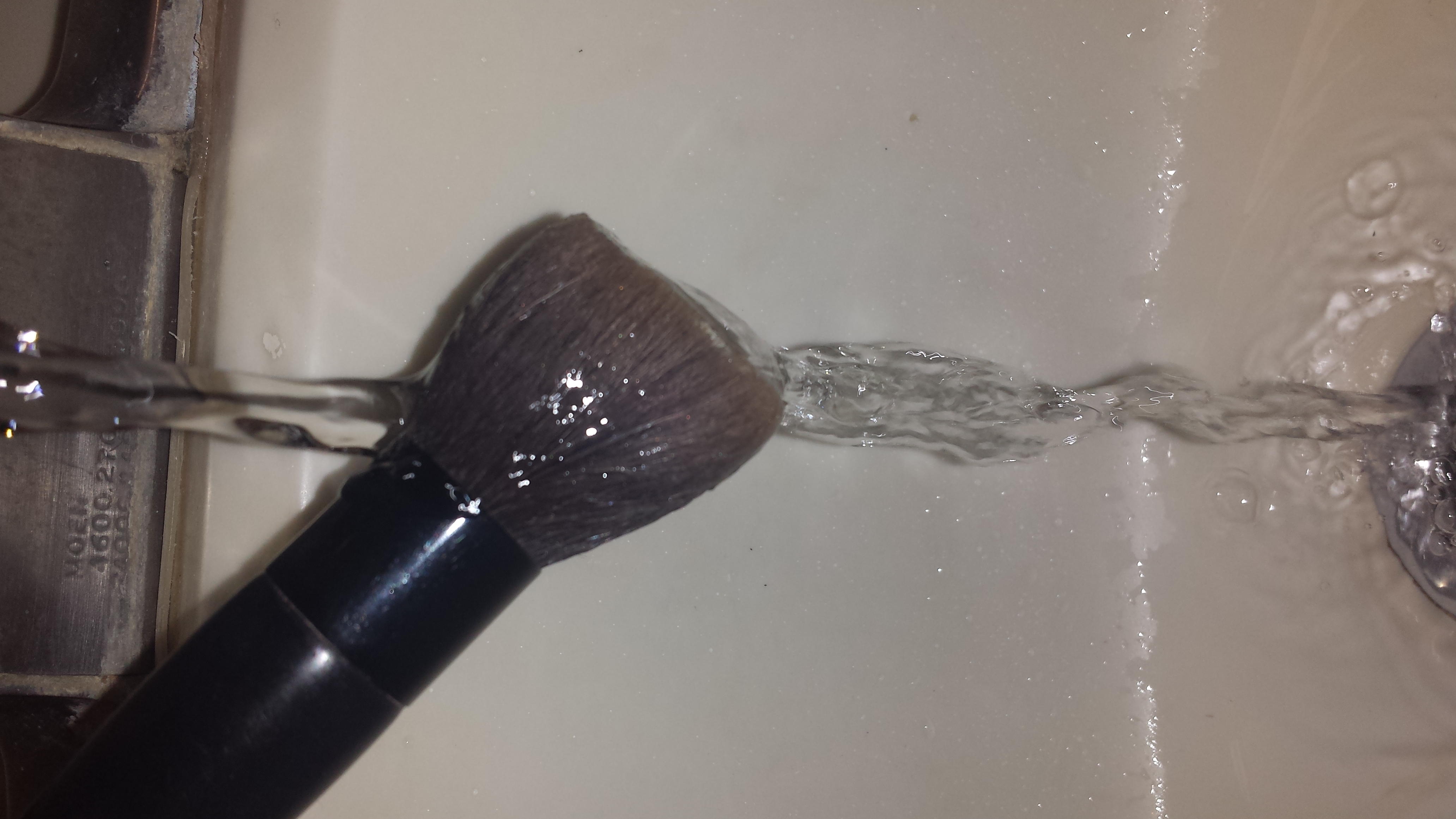 First wet your makeup brushes