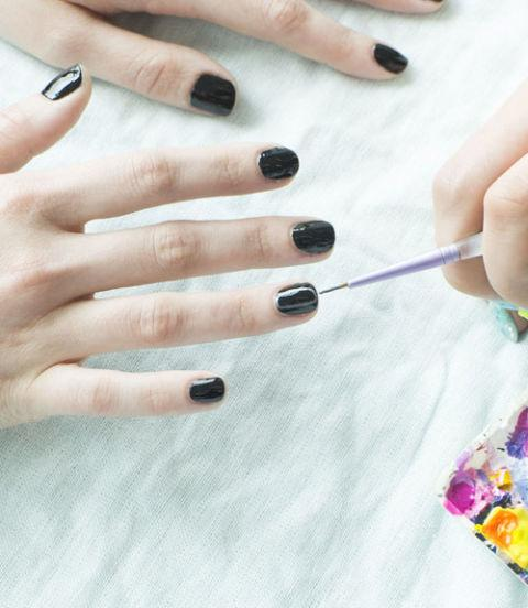 """Next, choose a few accent nails and a silver polish. With a thin pointed brush (you can find these in any beauty supply store), draw on the oblong shape with straight sides. """"Kathryn Wirsing"""""""