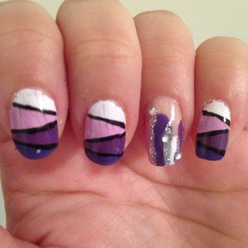 Block purple ombré , accent nail is random purple lines with glitter in between and silver gems