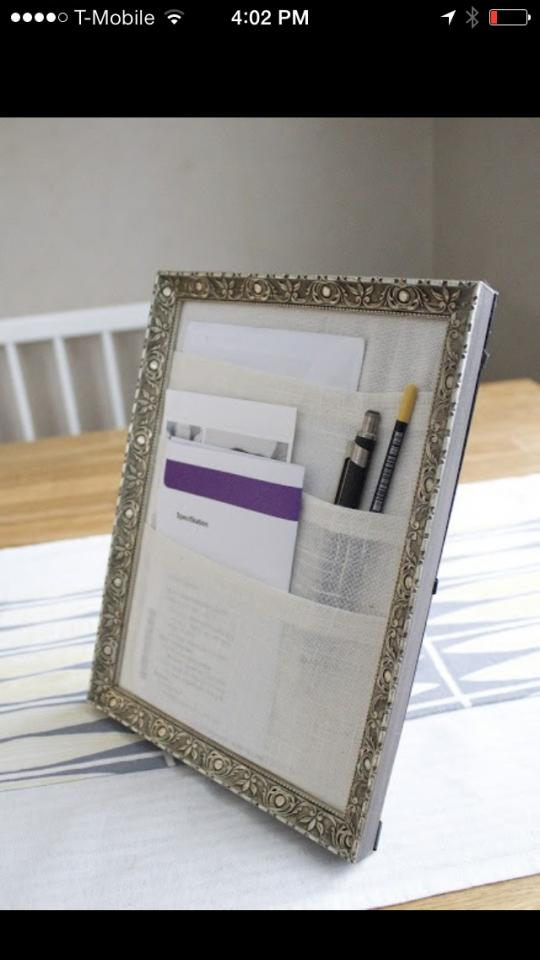 Hem 3 8x10 pieces of fabric and layer them in a tiered manor on the inside of the frames cardbord, then simply place inside the frame without the glass to hold pens, pencils, scissors and more!