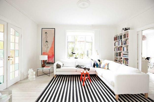 Use stripes to elongate the space Just like vertical stripes on clothing, a striped rug will make your room appear longer.