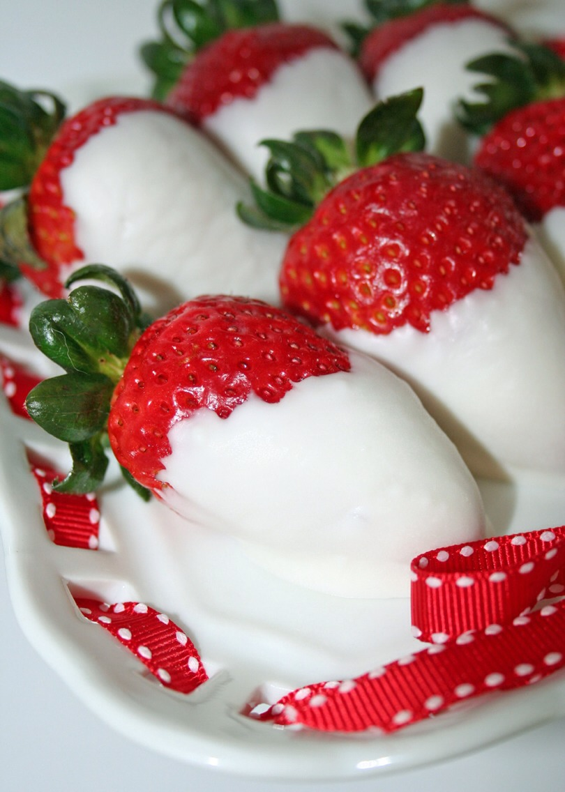 After 24 hours (or so), remove the strawberries from the jar of vodka and pat dry. Next dip into your favorite melted chocolate and let dry on wax paper. Once berries are dry plate, serve, and enjoy. Simple and oh so yummy!