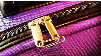 Use a paperclip to keep the zipper together on your makeup bag while traveling. No more broken makeup all over your suitcase/purse!