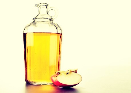 Take half a cup of the vinegar and half a cup of water (to dilute it and weaken the smell) and use it as a rinse after you shampoo! It makes your hair shine and stimulates the roots.