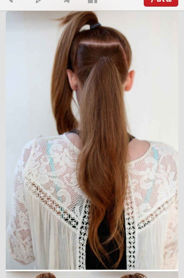 Part your hair into two sections and separate into two ponytails. Make the first a high pony and the second a lower one.