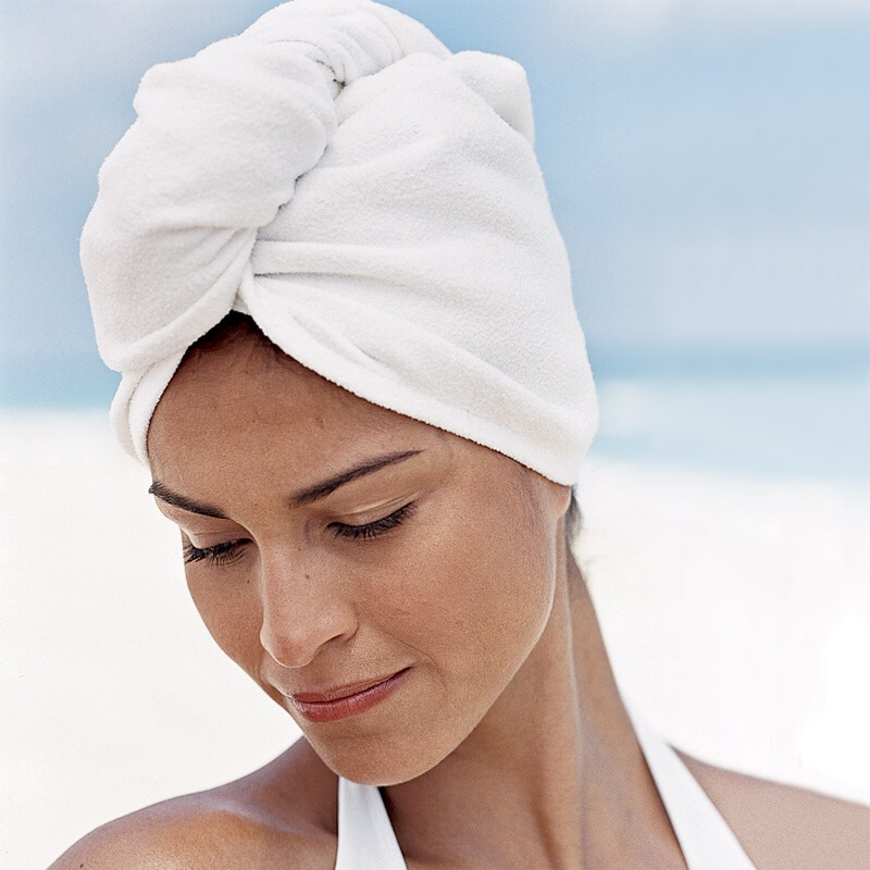 Don't use the twist towel on your hair. Squeeze the ends with the towel and pat it try. Never twist your hair between your palms or within the towel.