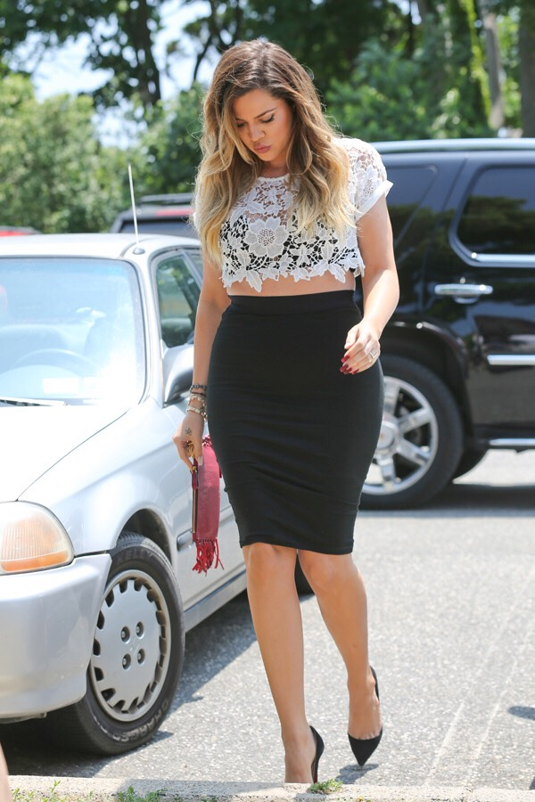 Laced crop top and a tight pencil skirt. Khloe sure knows how to rock curves and still look classy. The perfect day to night outfit. 🌇