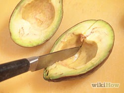 5) Alternately, slice the avocado. Using lengthwise cuts, cut into the avocado at even intervals. This process will create avocado slices that are beautiful as garnish.