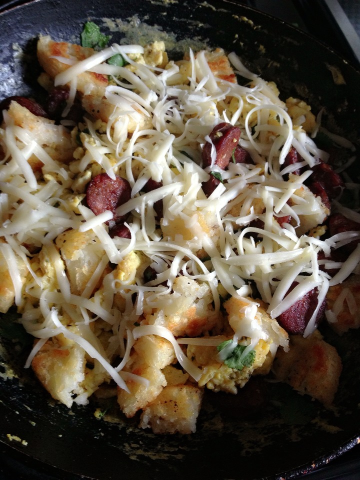 Add in the hashbrowns or country fried potatoes & sprinkle with your favorite cheese