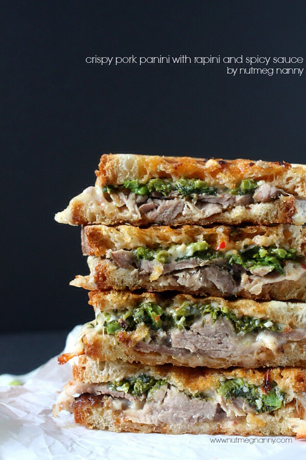 This crispy roast pork panini is full of flavor and is filled with fresh roast pork, rapini, homemade spicy sauce and provolone cheese.