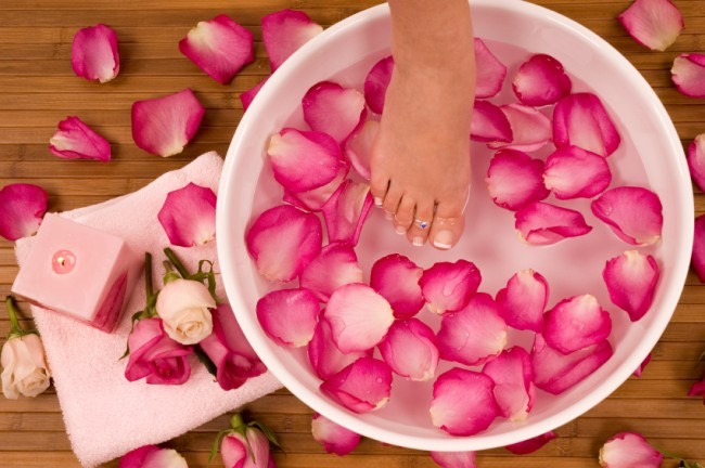 This may seem strange, but rose water actually has a lot of benefits, including helping to heal dead skin. Mix some warm water together with some rose water and rose petals if you have some around, then soak your feet in it for about 20 minutes