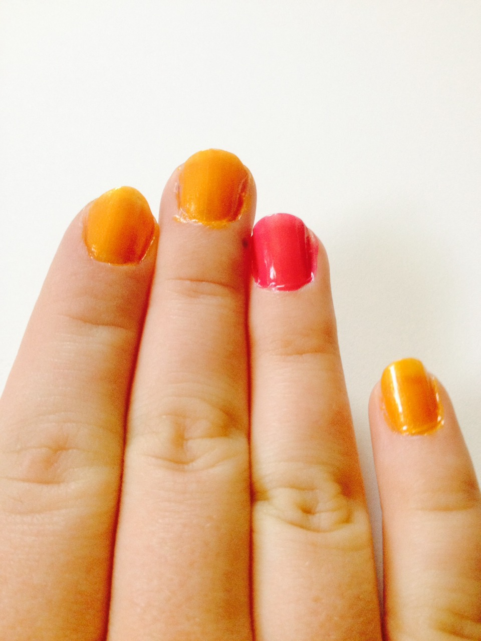 Paint one nail on each hand pink, then paint the rest orange.