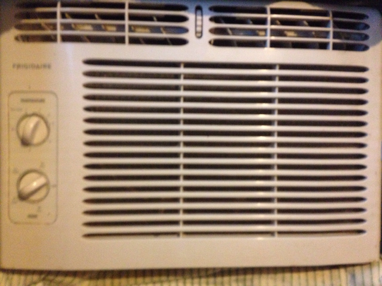 Spray Febreze on your AC filter and it will help your room smell good quick !