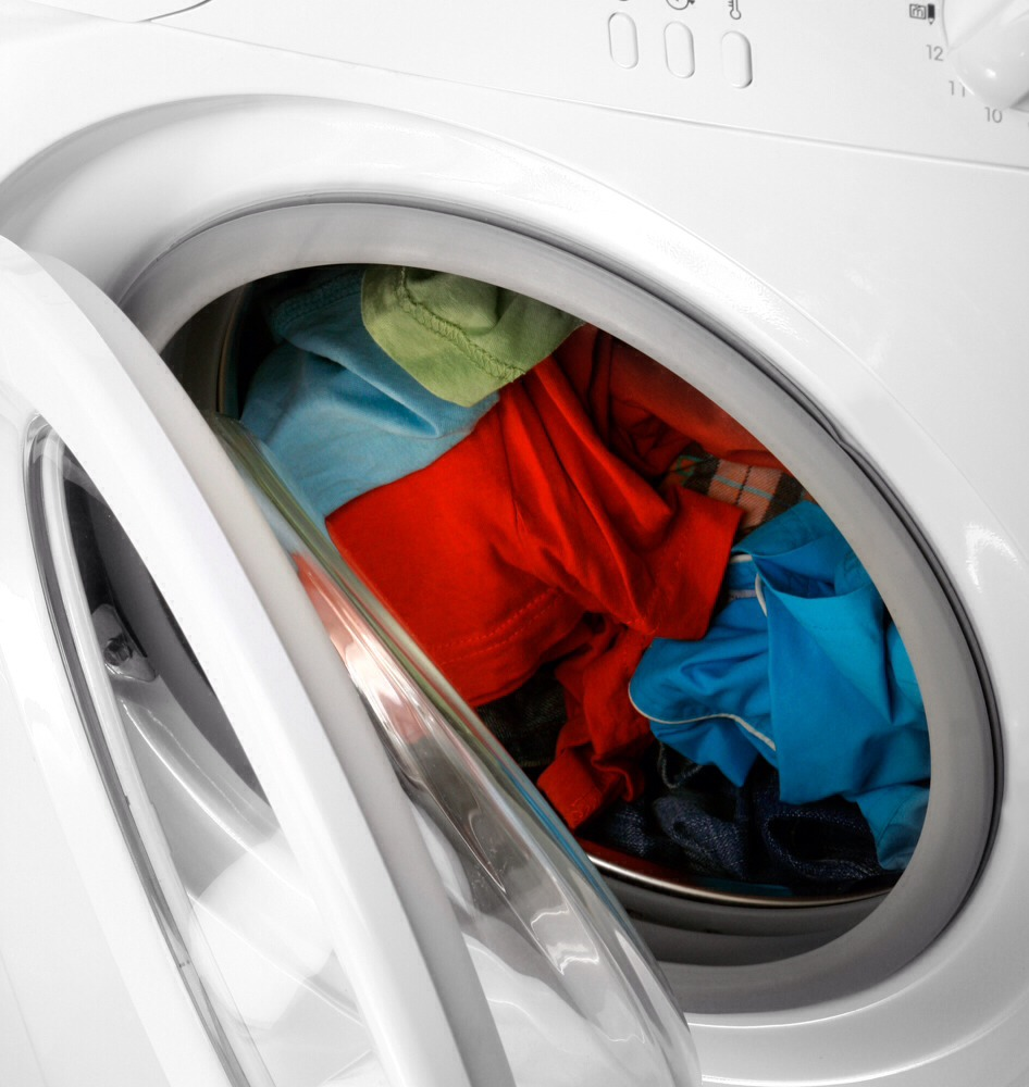 Wash the clothes that have the oil on them in their own load twice to make sure to remove the oil off