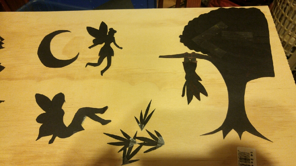 cut out your fairies and anything else you want in the scene. I just used black construction paper.