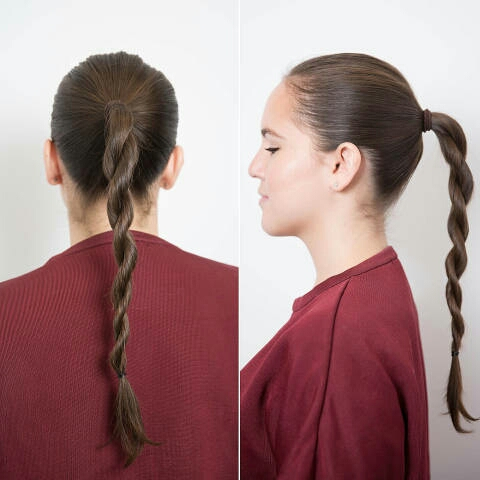First, put your hair into a ponytail and create two sections, and twist each one in the same direction. Then, cross the two sections over each other and secure it at the ends with an elastic band. Pro tip: Keep pomade on your fingertips to keep any stray strands in place, and use hairspray.