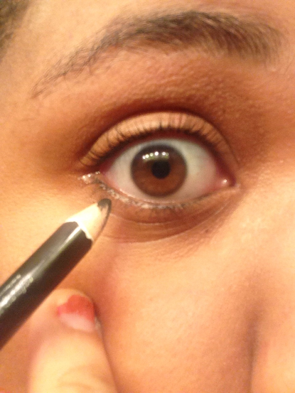 use a pencil eyeliner and go on your waterline, as far up as your tear duct.