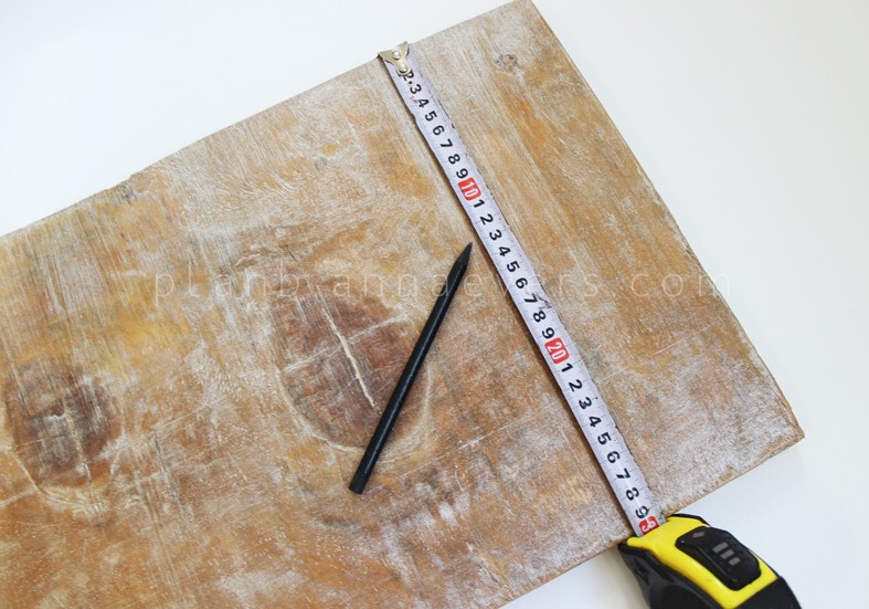 Process: 1.Measure your wood board and divide it marking dots with your pen (depending on the width of your board) with a space of about 10-15cm between each dot.