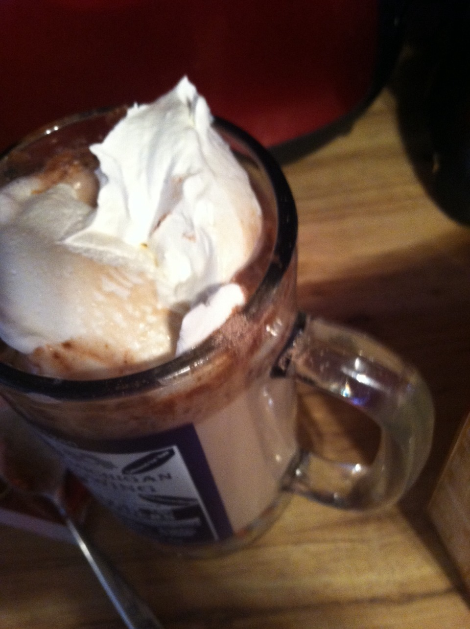 Put the cool whip on top of the cocoa.