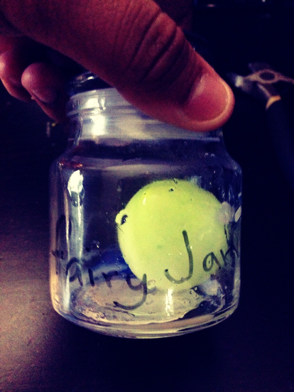 Put the ballon in the jar then close it and label it and then put it under the light to glow in the dark.