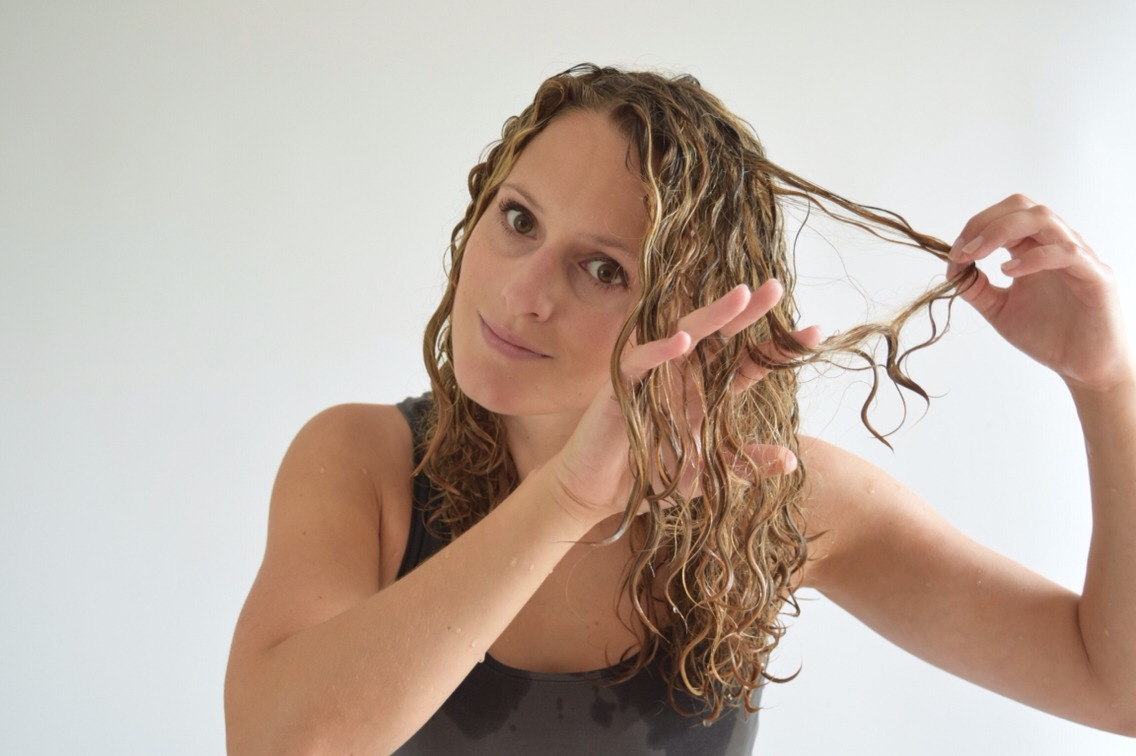 Firstly, GENTLY separate the end of your hair   The tangles formed are due to the curly strands of hair entwined together. Gently separating the knots with our fingers allows us to be more delicate and intricate than a comb will be.