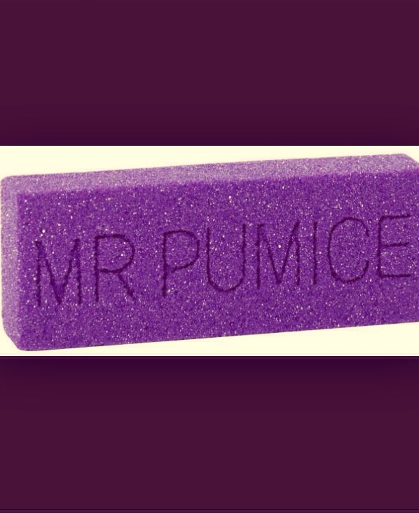 Try using a Mr. Pumice footcare stone on the walls of your fiberglass shower. It removes the hard water with ease and does not scratch the surface. No chemicals needed, just gently rub on the walls with the walls and pumice stone wet. Works great!