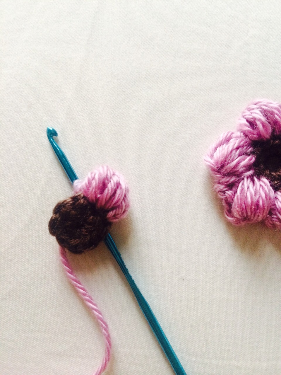 Slip stitch into next loop, your first petal is formed, repeat pattern to form next petal starting with chain 3.