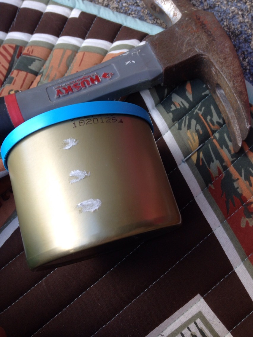 Need a nail, hammer, and an empty tin can that you like (I choose this Blue Diamond Almonds tin because of the brassy color and size)
