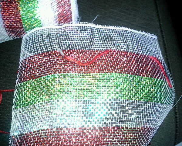 tape the toothpick and yarn together and pass it thru the mesh. (my mesh was about 4 feet). pull it together and tie.
