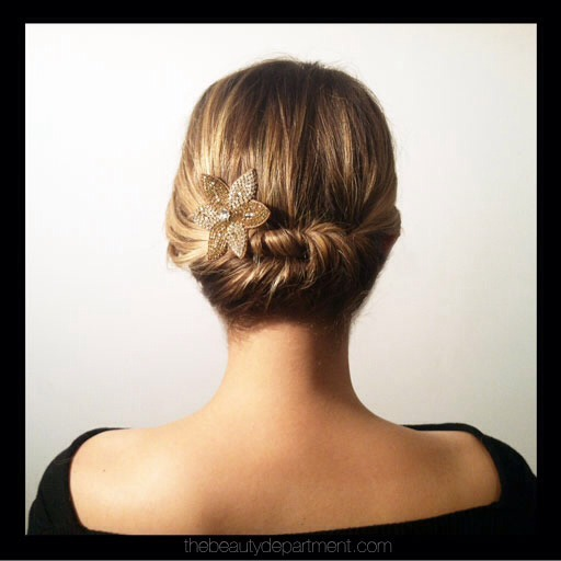 Add a sparkly accessory and this will make a great New Years Eve updo for you shorties!