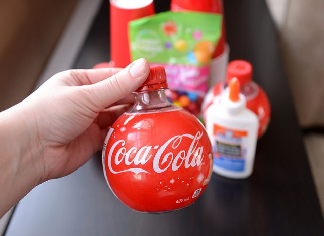 Grab your Coca-Cola bottle and remove the label. Wash and thoroughly dry the bottle.