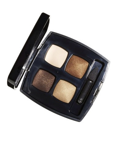 1.  Pick a multitonal eye-shadow palette, like the one at left. Prime your lid by patting on regular foundation — it'll form a base for your makeup to stick to.