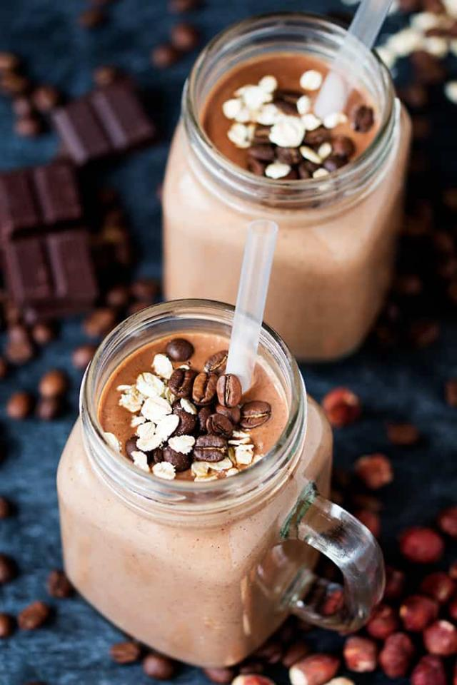 Oaty Mocha Hot Smoothie  Ingredients 15 g (0.5oz - about 4 small chunks) dark chocolate, chopped 240 ml (1 cup milk) unsweetened almond milk 1 oz shot of espresso or 1 tsp instant coffee granules mixed with 2 tbsp water 3 tbsp rolled oats  ½ a ripe medium sized banana 8 hazelnuts 1 tsp chia seeds 1 tsp maca powder optional 2 tbsp cold water  Instructions 1. Add the dark chocolate to a jug, pour in the milk and the espresso. Microwave until the mixture is warm and the chocolate has melted (you can do this in a pan if you prefer). 2. Place the oats, banana, hazelnuts, chia seeds, maca powder, the water and approx. a fifth of the milk mixture to your smoothie maker or blender. Add in an extra splash of cold water if you think the liquid is too warm. 3. Blend on high for a minute until the oats and chia seeds have been completely incorporated. Whilst it's blending, further heat the rest of the milk mixture until hot, but not boiling. 4. Pour the blended oat mix into your cup, stir in the milk/chocolate mix and serve.
