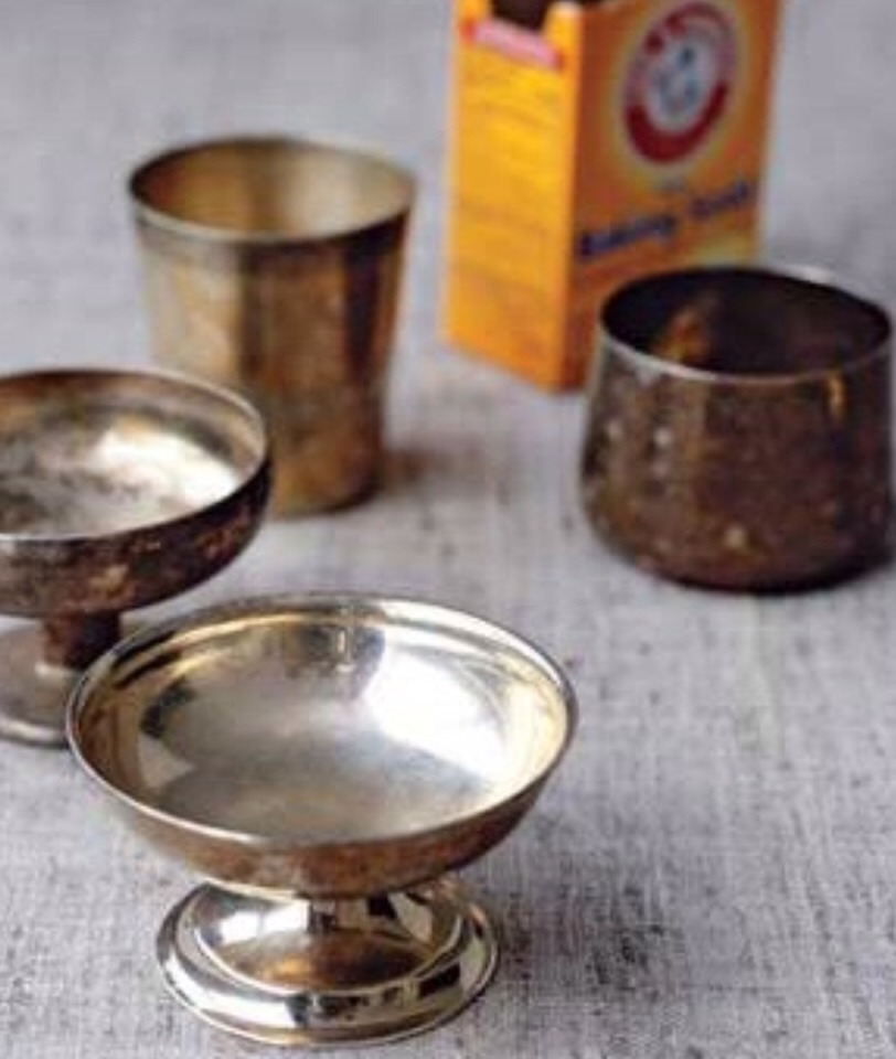 Baking Soda as Silver Polish To polish silver: Wash items, then place on aluminum foil in the bottom of a pot. Add a baking-soda solution (¼ cup soda, a few teaspoons salt, 1 quart boiling water) and cover for a few seconds. The result? A chemical reaction that gets the black off the gravy boat.
