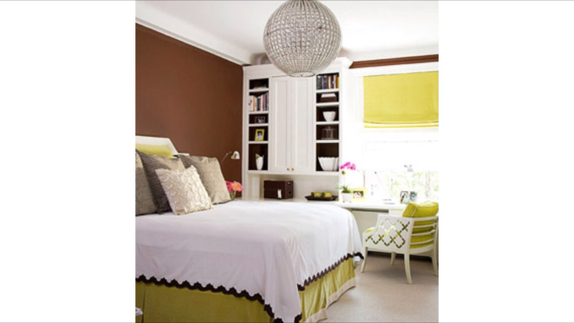 Create drama!! add drama with contrast. In this chic bedroom, drama is created through size and color. The eye is immediately drawn to the hanging globe fixture. The large size creates instant drama. And the contrast between the chocolate-brown walls and the  lime splash bedspread.