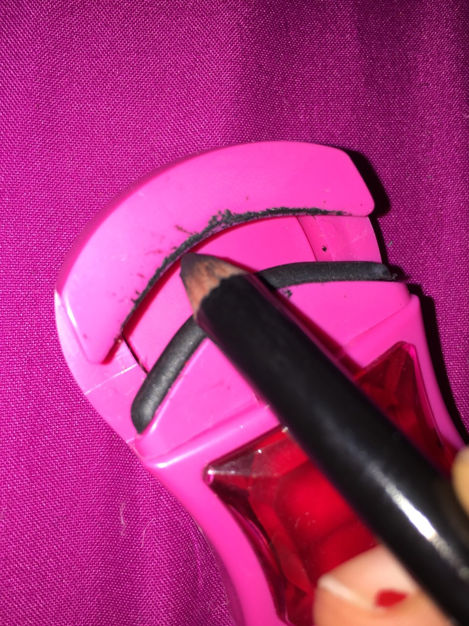 Applying pencil liner to the top of your eyelash curler and the curling the base of your lashes will apply top liner and save time.