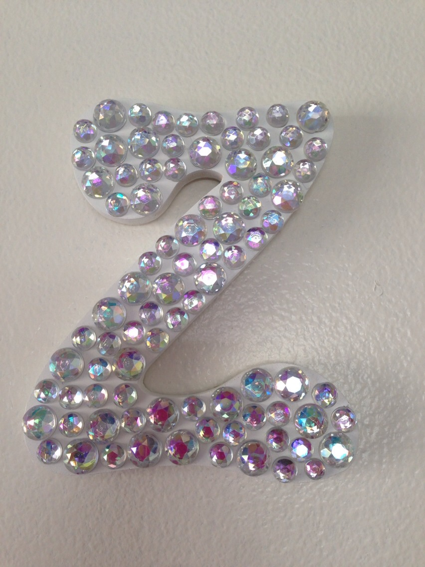 Instead of plain color lettering for baby's name on the nursery wall, glue gemstones on them instead! Girls love the sparkles!
