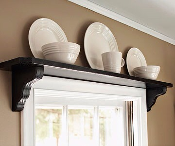 Over-door Shelf  Mount a shelf over the door to hold baskets of essential items.