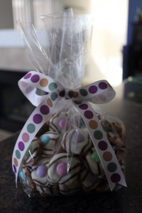 7. Place handfuls of the candies in clear plastic bags and tie on colorful ribbons.